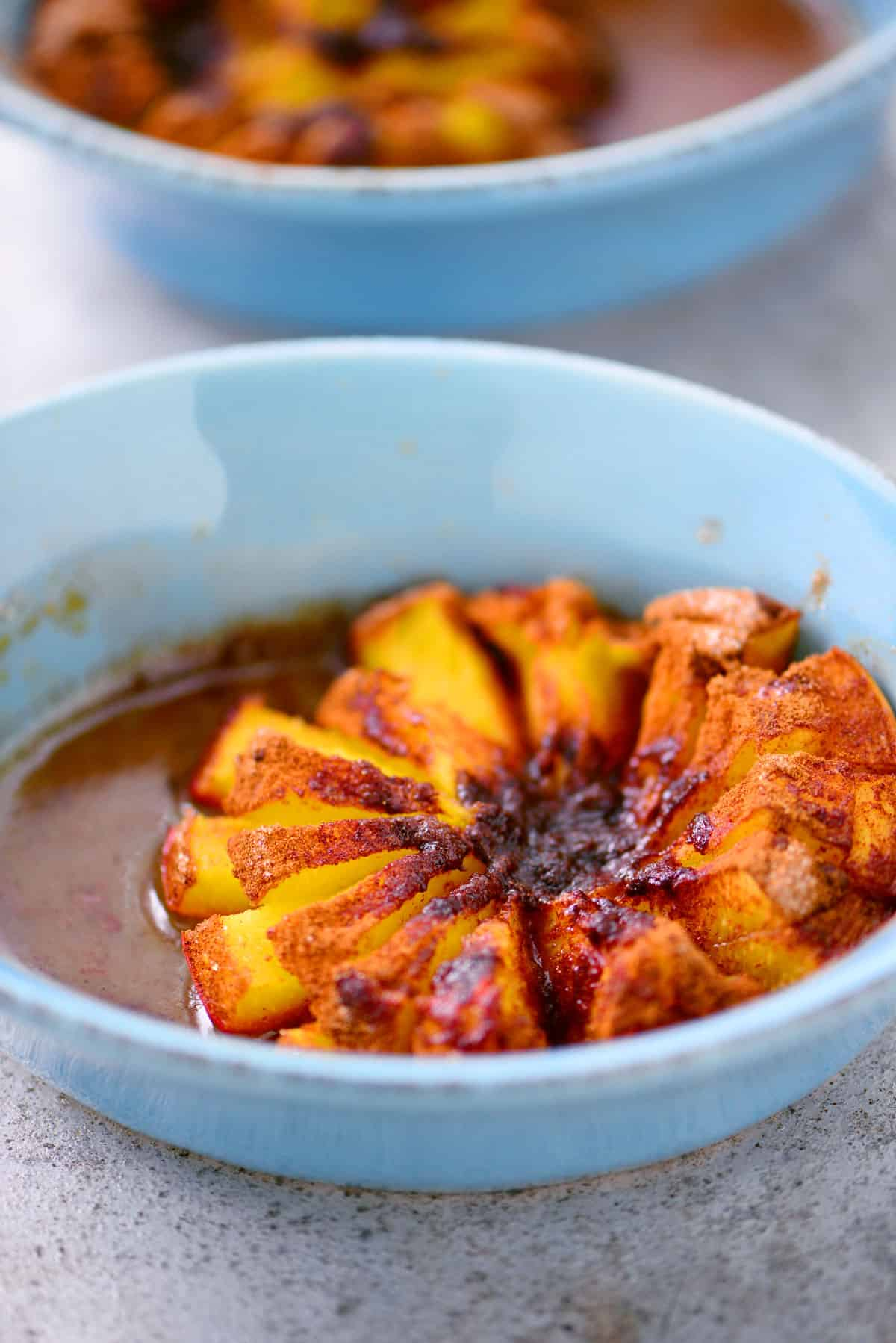 baked peach in blue dish