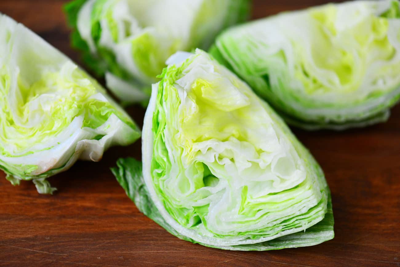 iceberg lettuce cut into four wedges