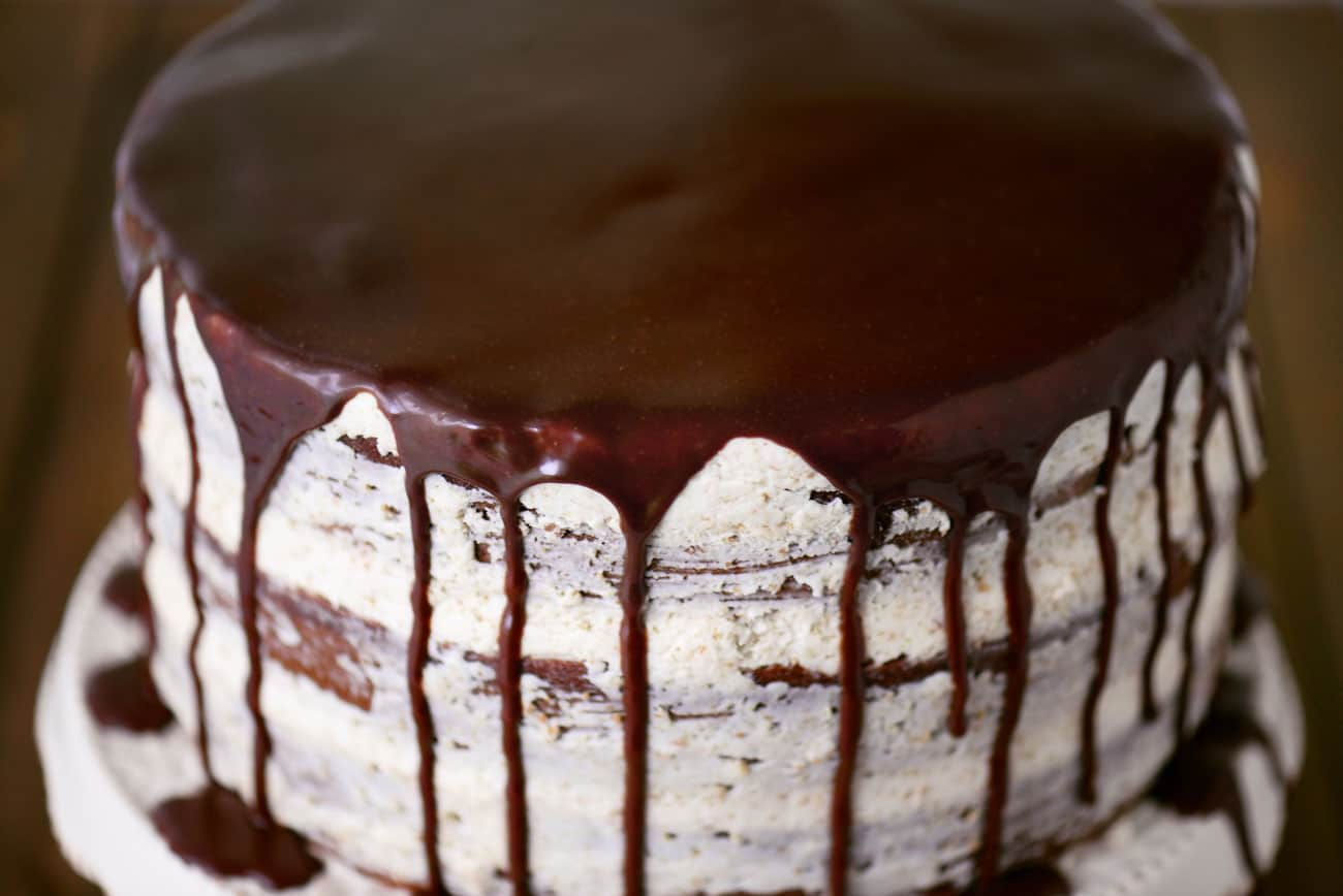 chocolate ganache drizzled over a cake