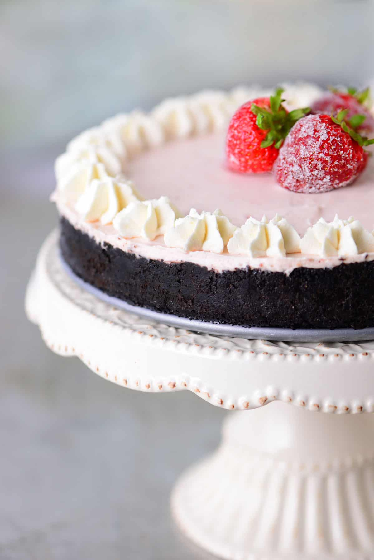 no bake strawberry cheesecake on a cake platter