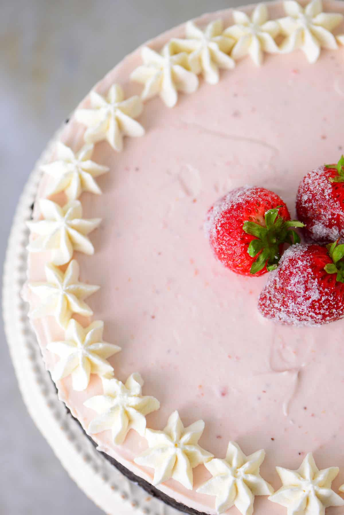 strawberry cheesecake with sugar coated strawberries on top