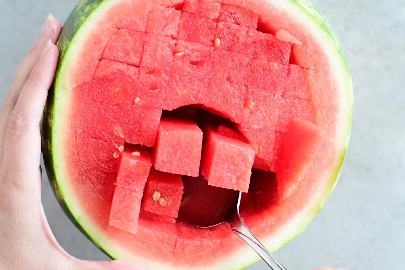 scoop out watermelon slices for watermelon salsa
