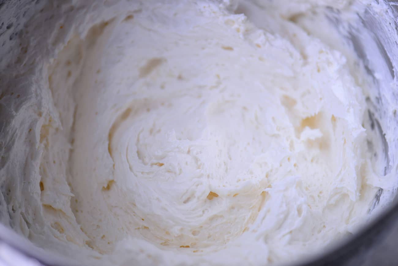 whipped cream cheese topping in a mixing bowl