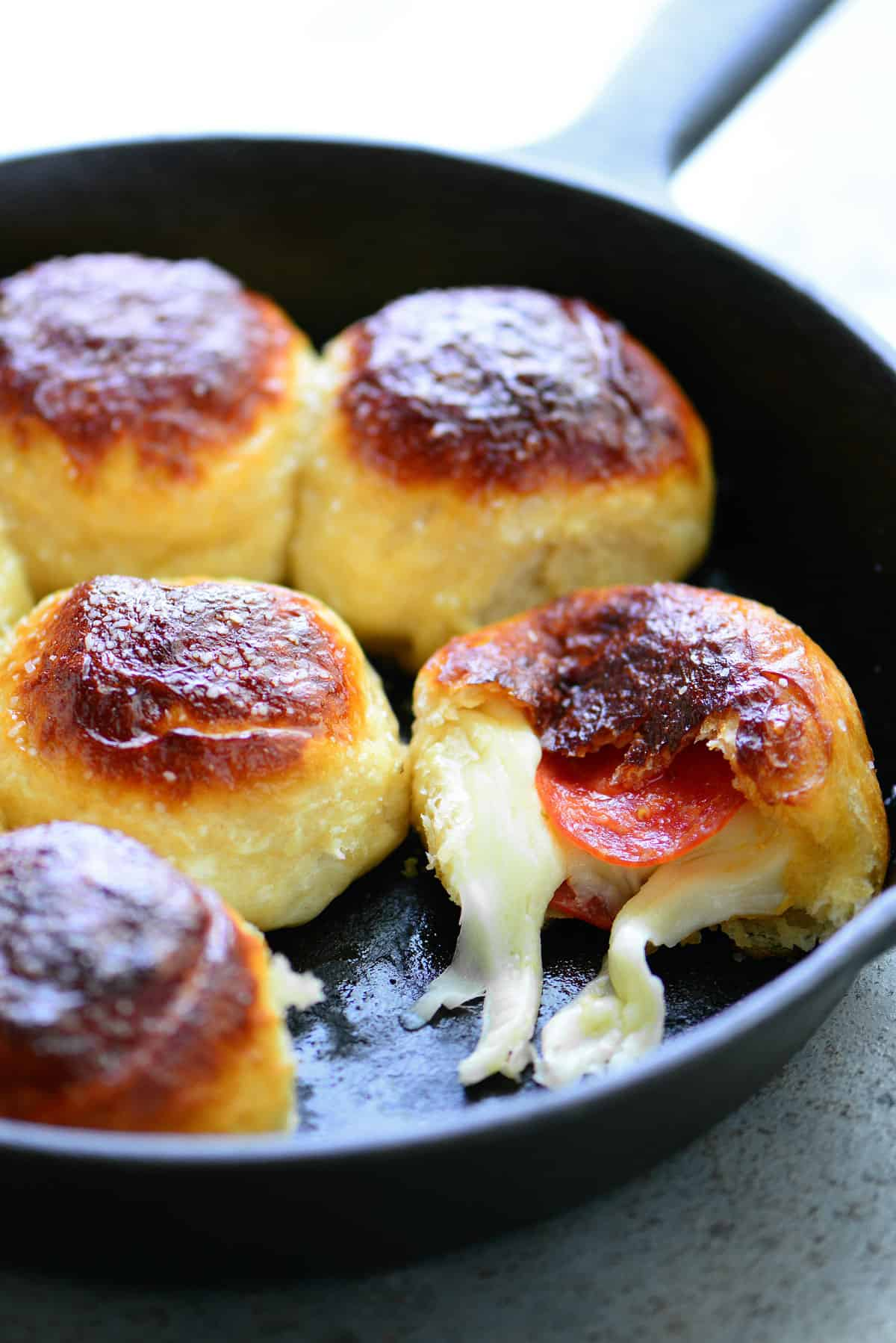 cheese coming out of the dough in a pan