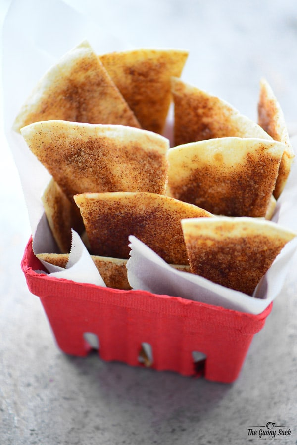 baked cinnamon chips in a paper carton