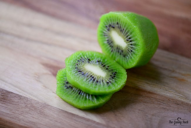 kiwi with two slices cut out of it