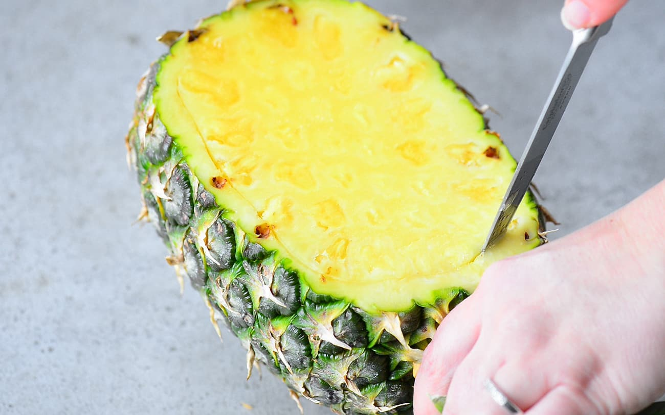 making a pineapple bowl for pineapple salsa