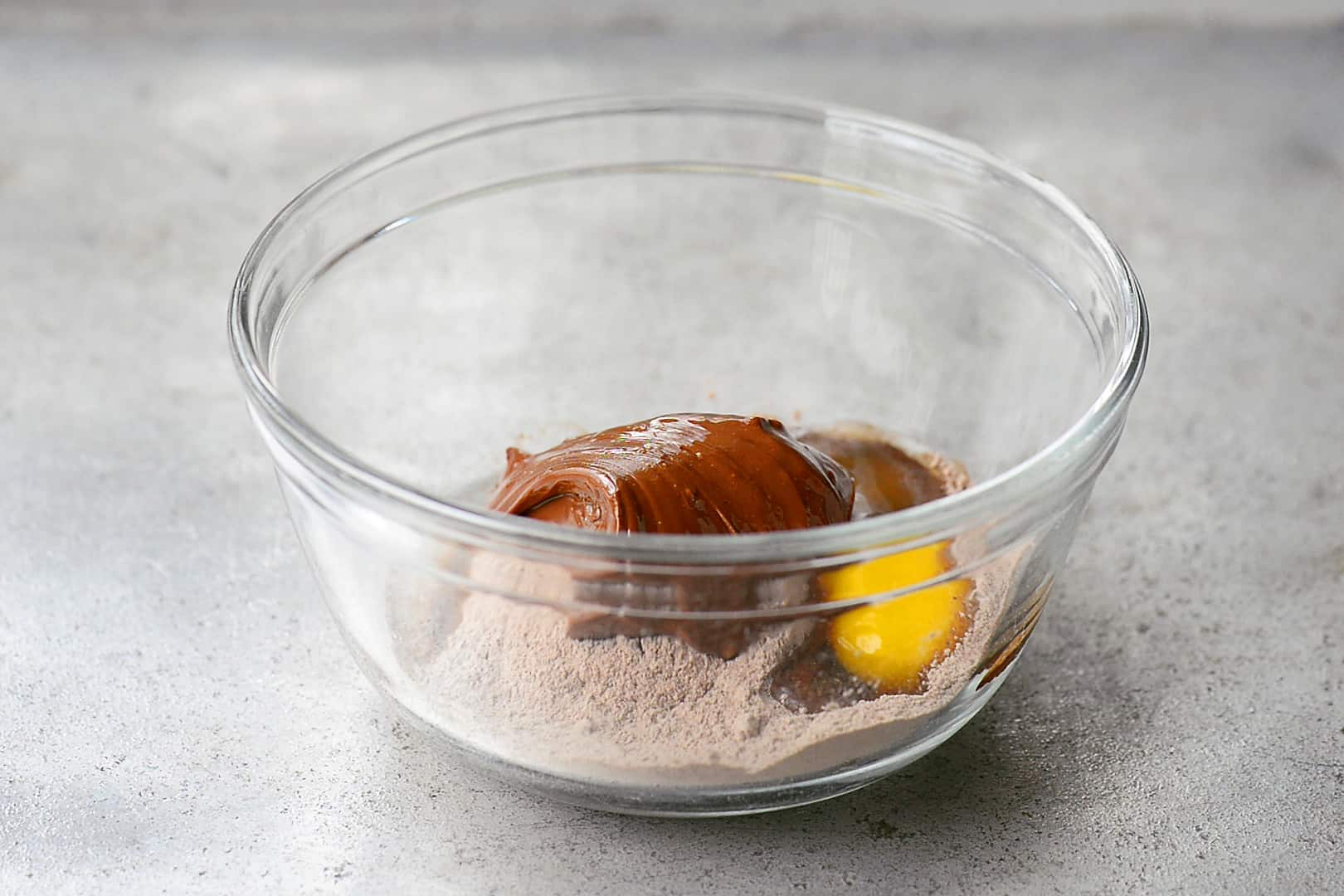 Pudding Mix, Egg and Nutella In A Glass Bowl