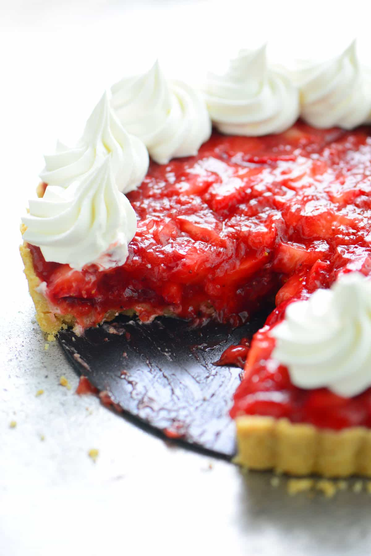 strawberry pie with slice removed