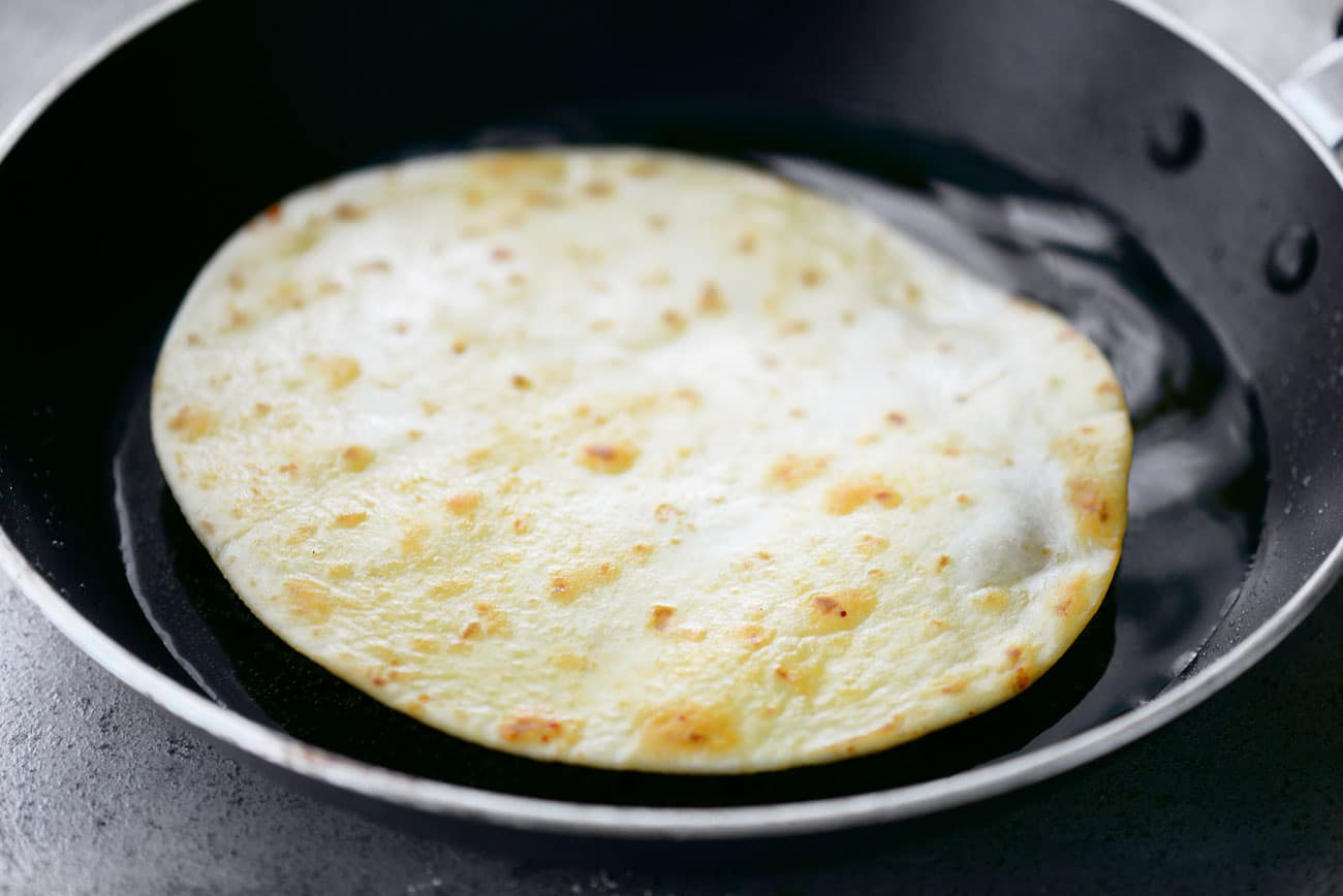 Frying Tortilla in Pan with Olive Oil