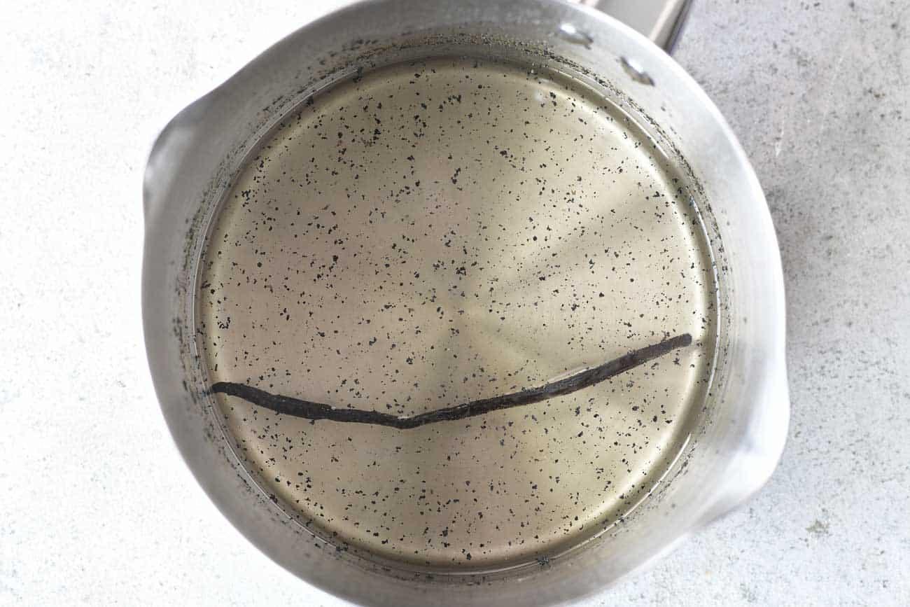 boiled vanilla bean syrup in a saucepan