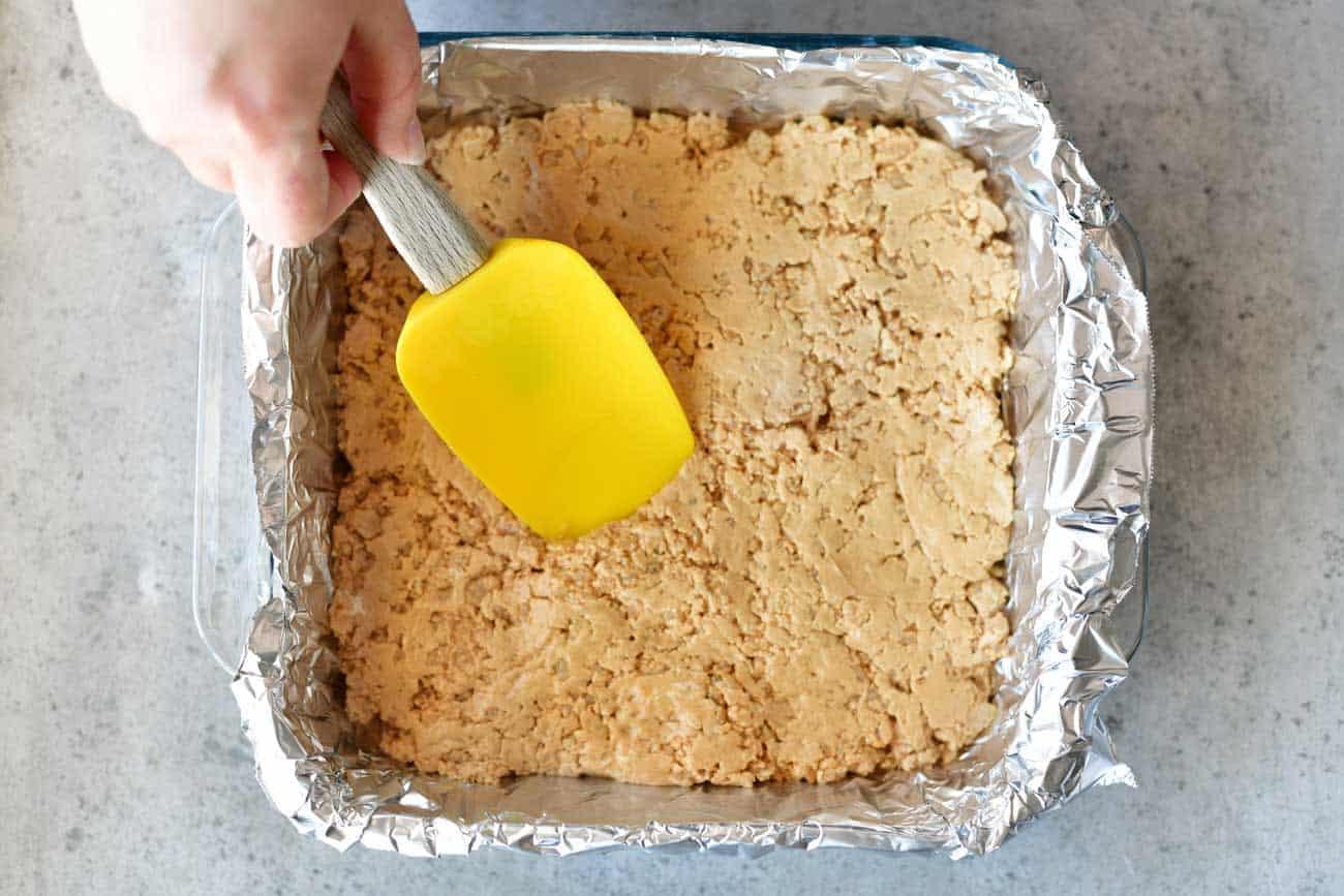 flatten peanut butter bars with a spatula