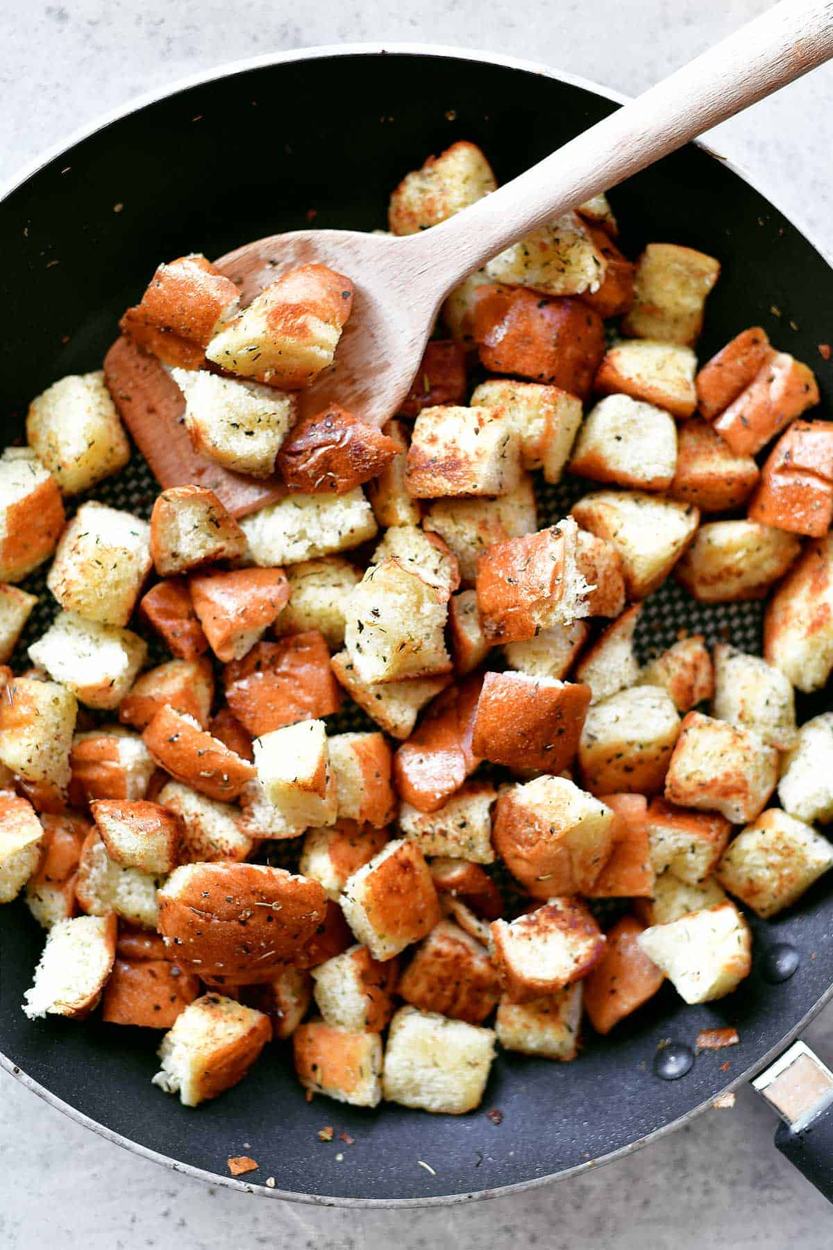 garlic and herb croutons in skillet
