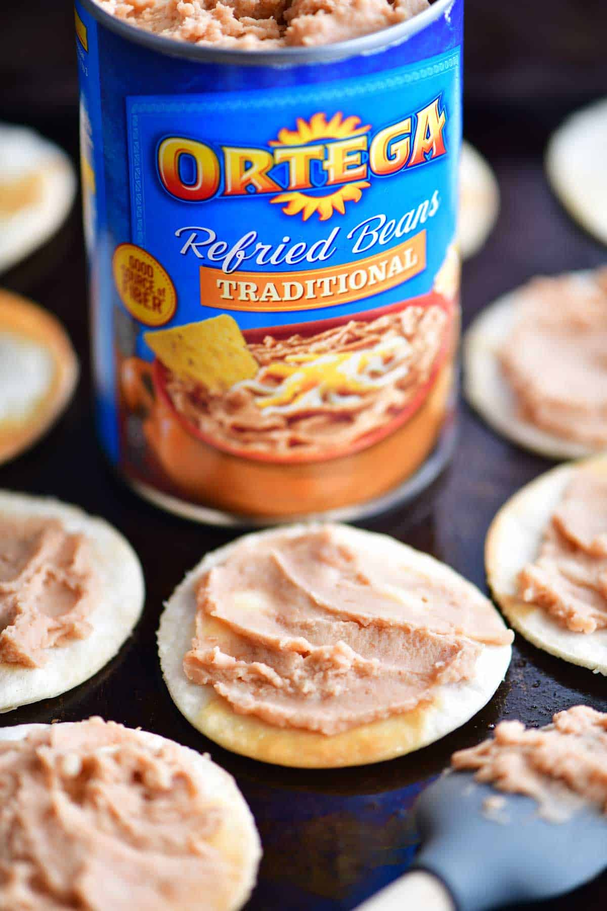 refried beans on the mini chicken taco pizza crusts