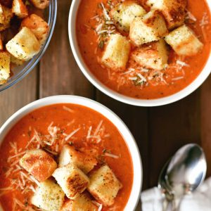 Pizza Soup in bowls on table with spoons