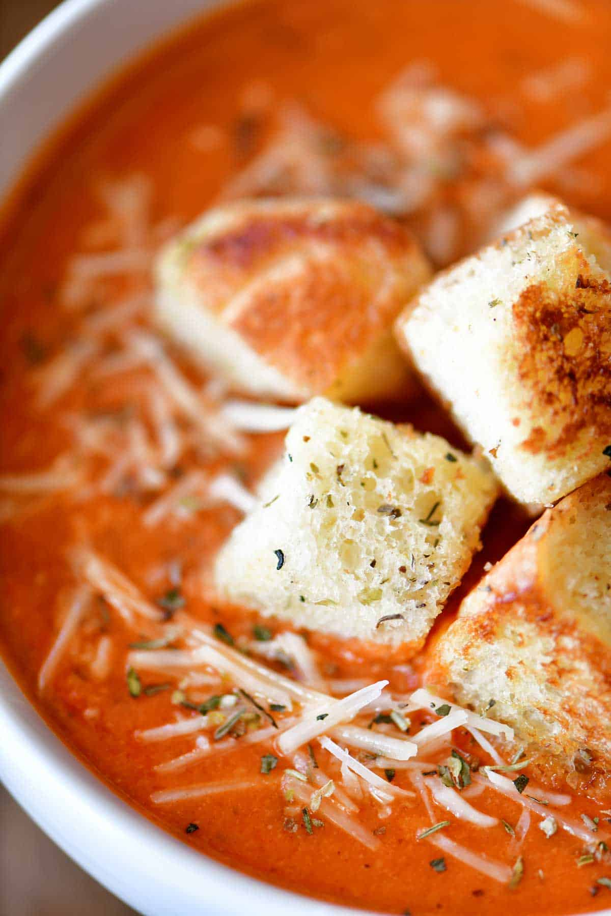 pizza soup in bowls with cheese and croutons