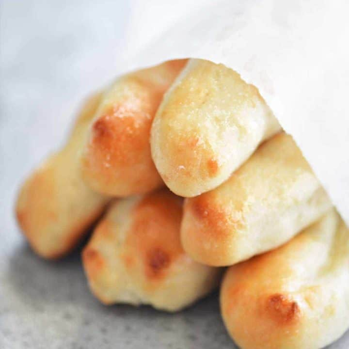 stack of two ingredient dough breadsticks wrapped in parchment paper