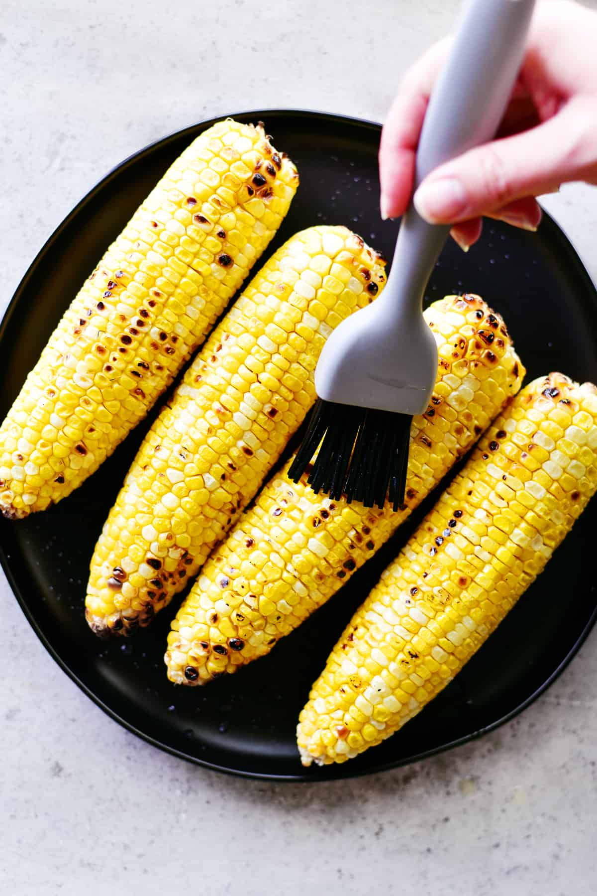 buttered grilled corn on the cob peeled