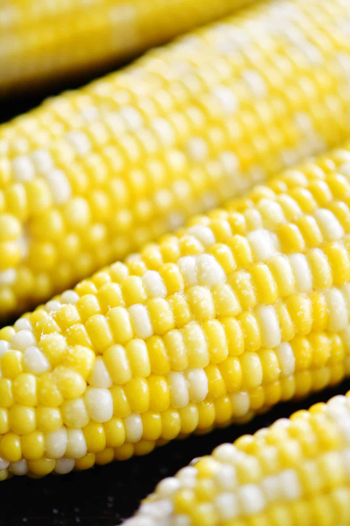 oven roasted corn on the cob with the husks with butter
