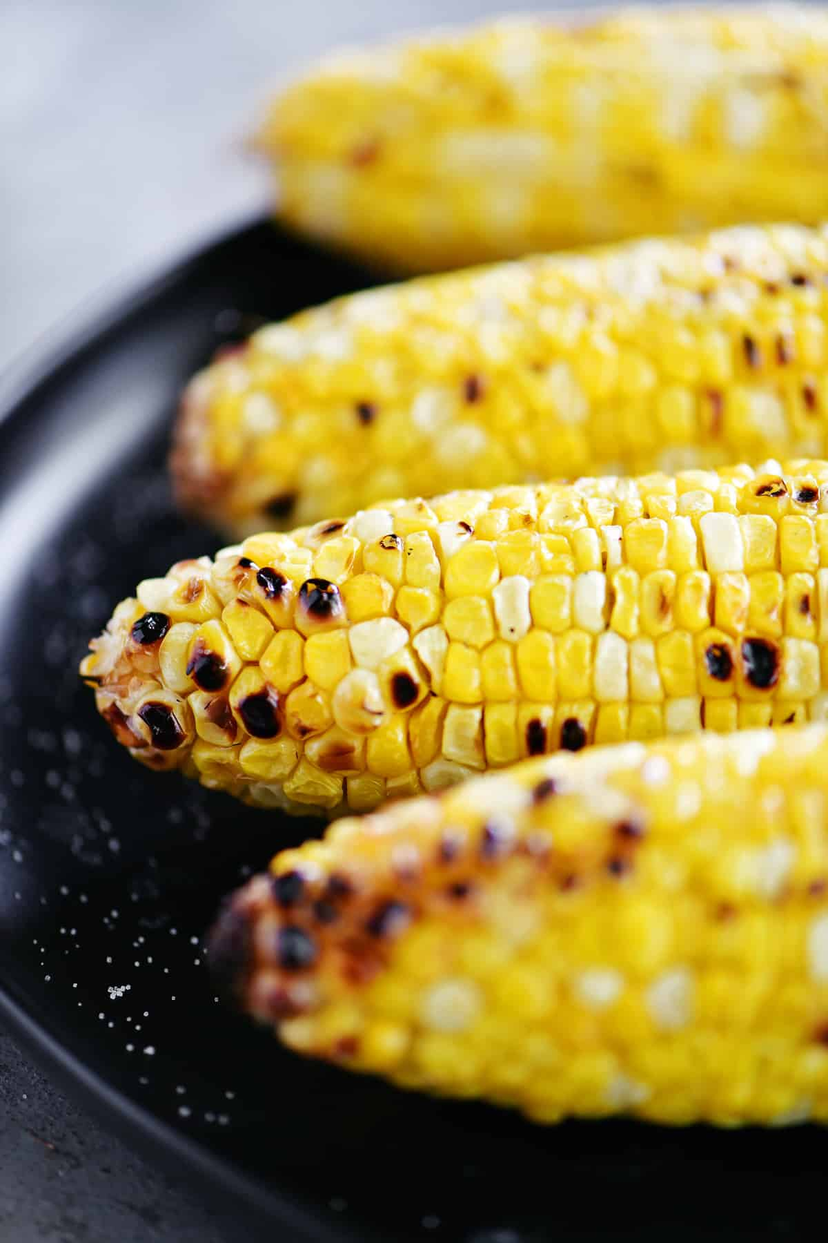 platter of grilled corn on the cob