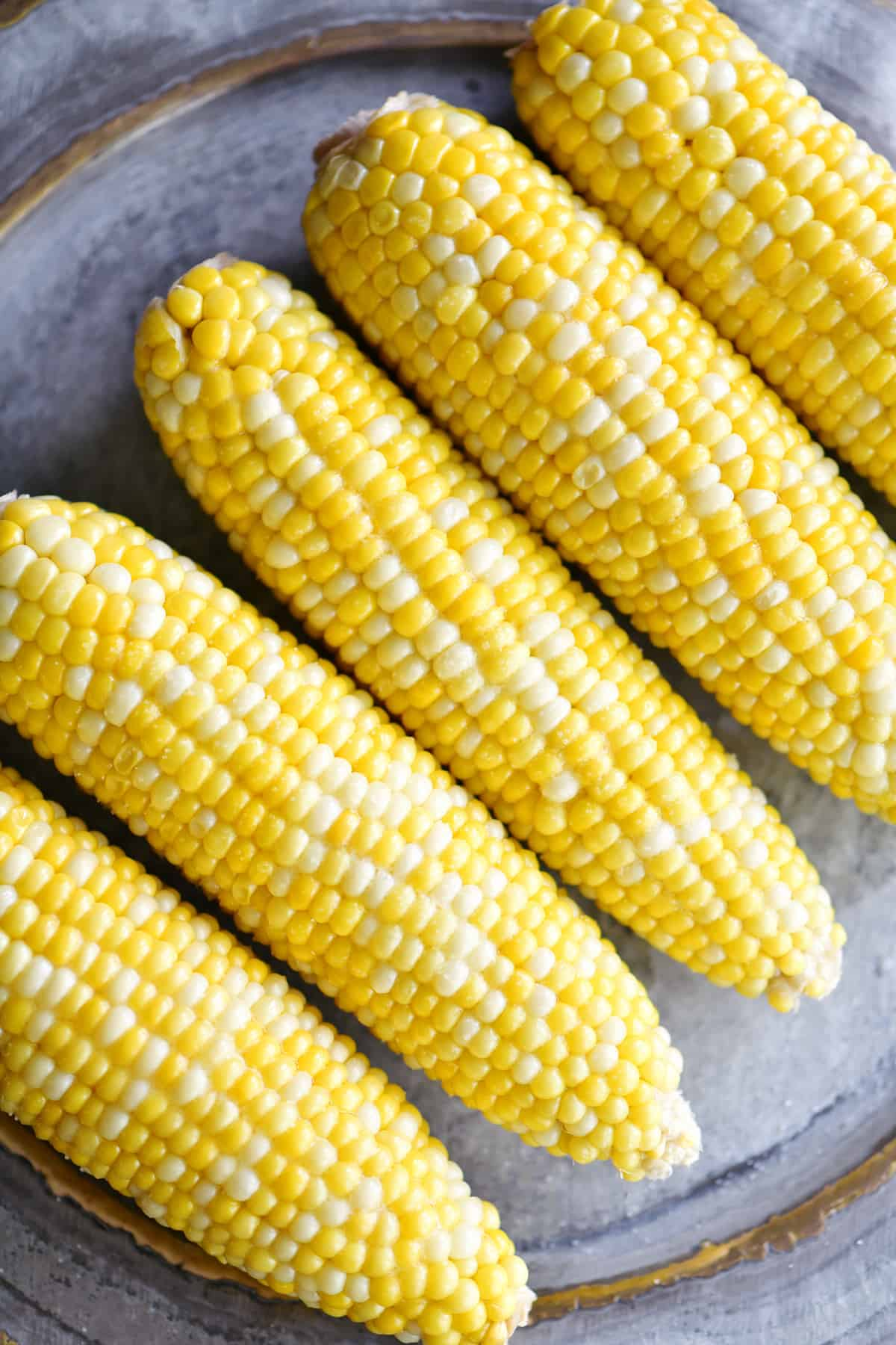 slow cooker corn on the cob on a platter