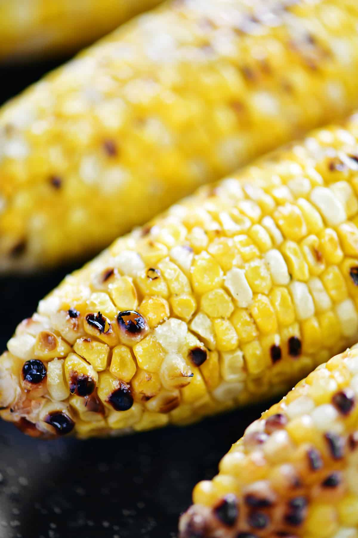 grilled corn on the cob shucked closed up