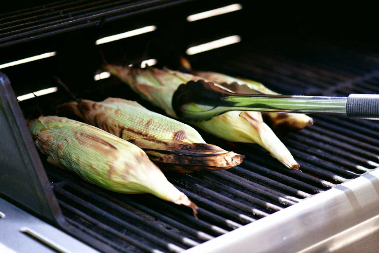turn grilled corn on the cob with husks