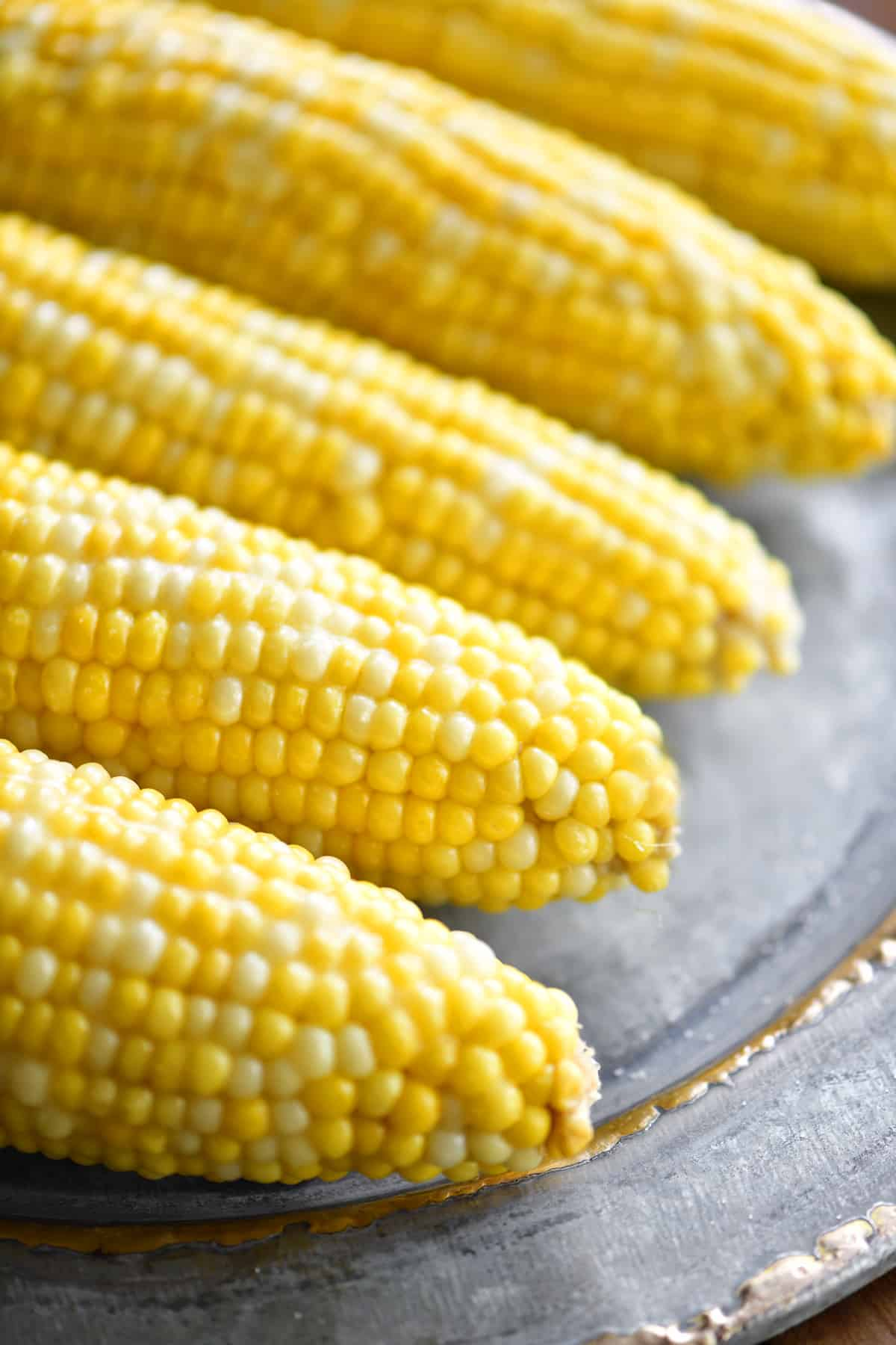 platter of slow cooker corn on the cob