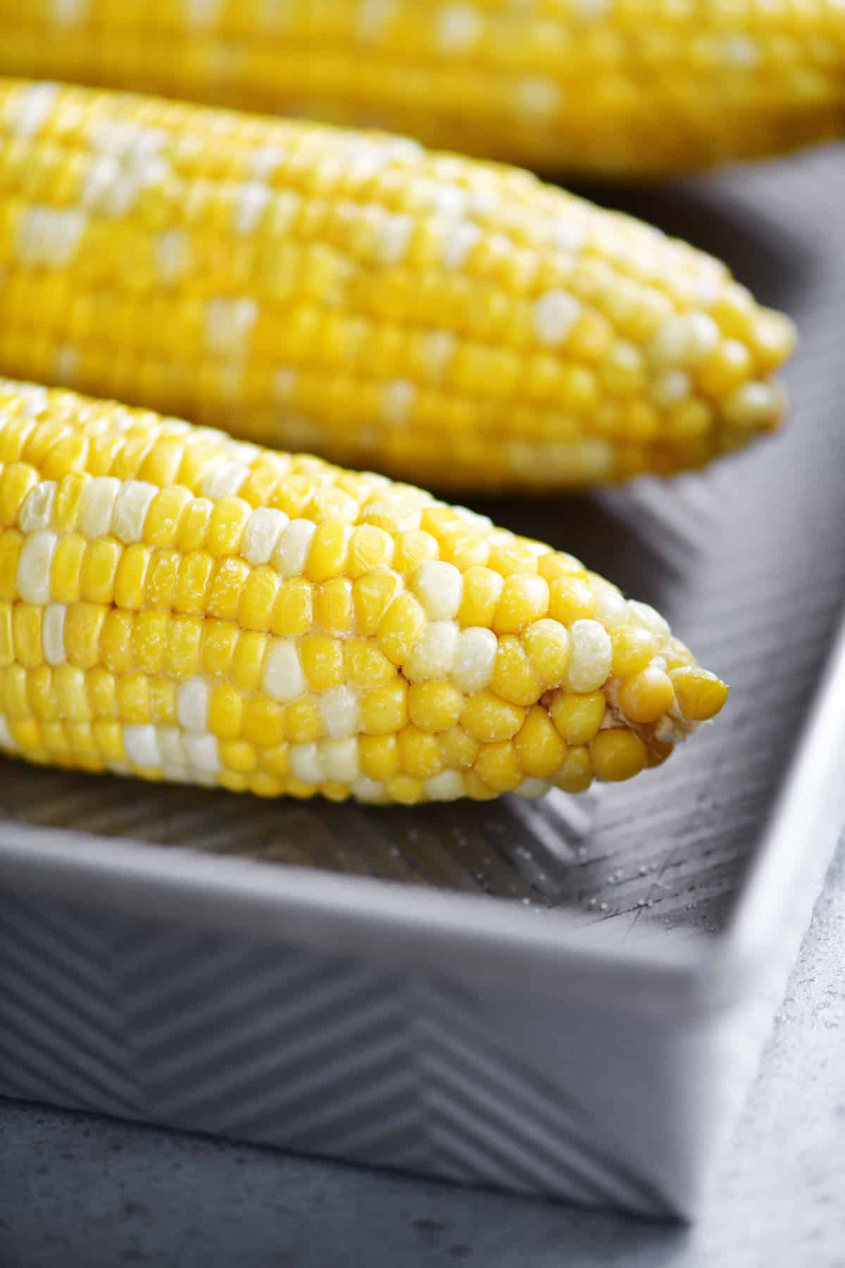 oven roasted corn on the cob in a pan