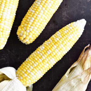 peeling oven roasted corn on the cob