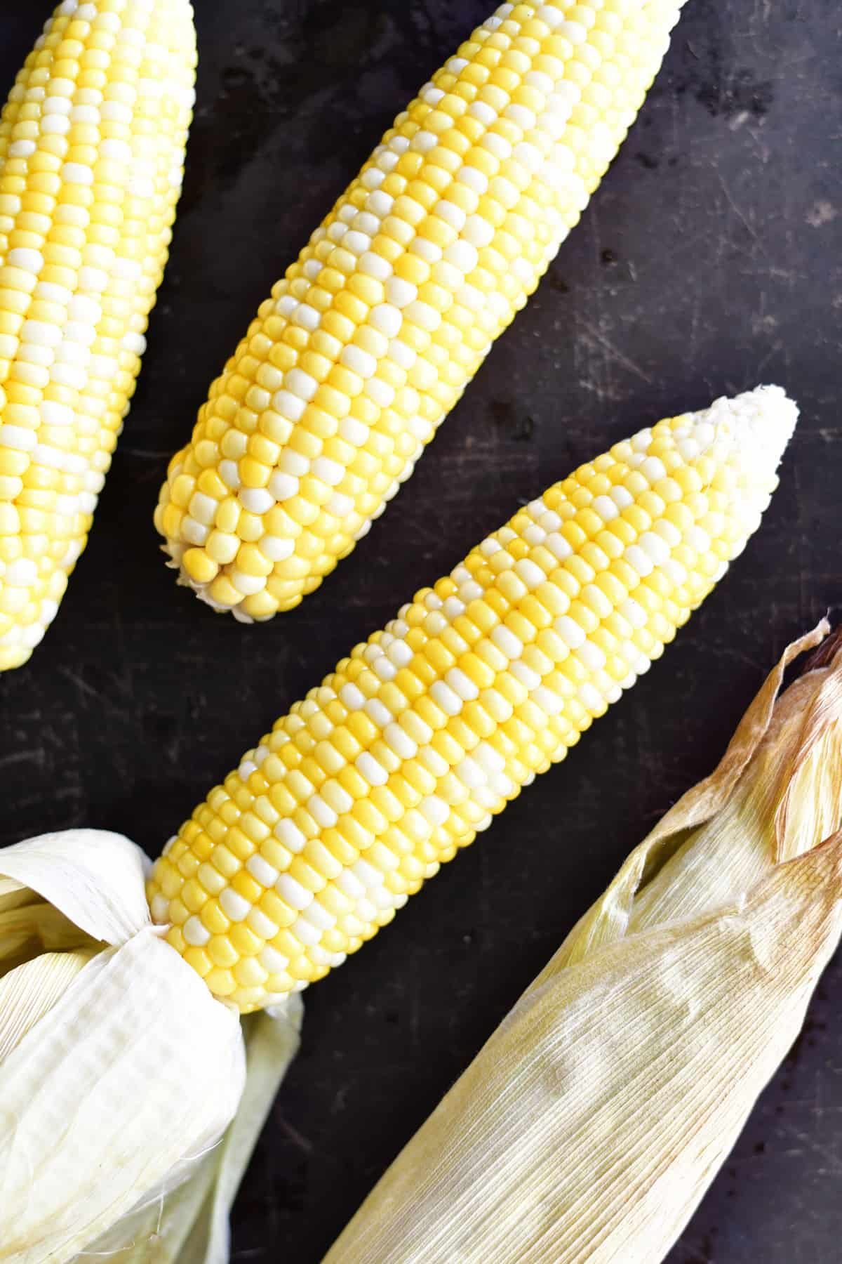 peeling oven roasted corn on the cob