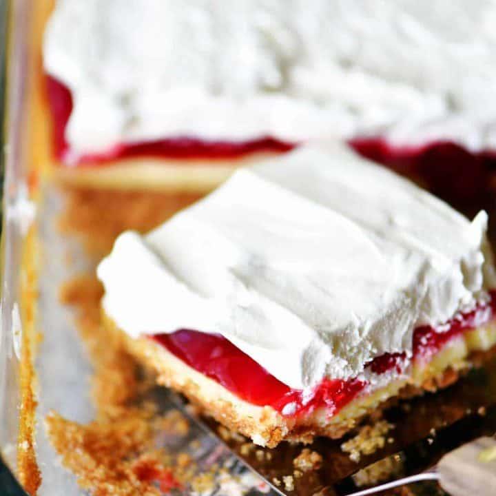 strawberry cheesecake dessert slice in pan