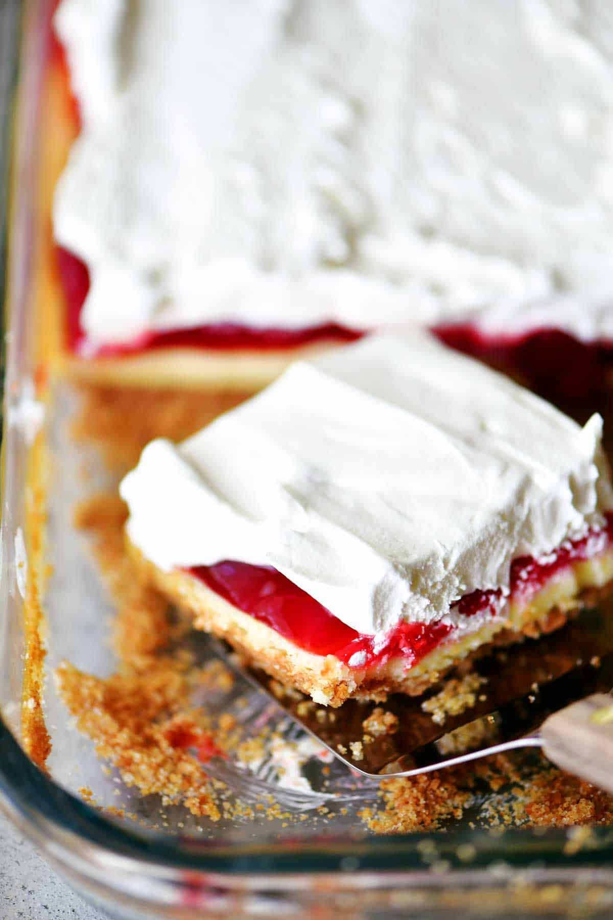 strawberry cheesecake dessert slice in pan