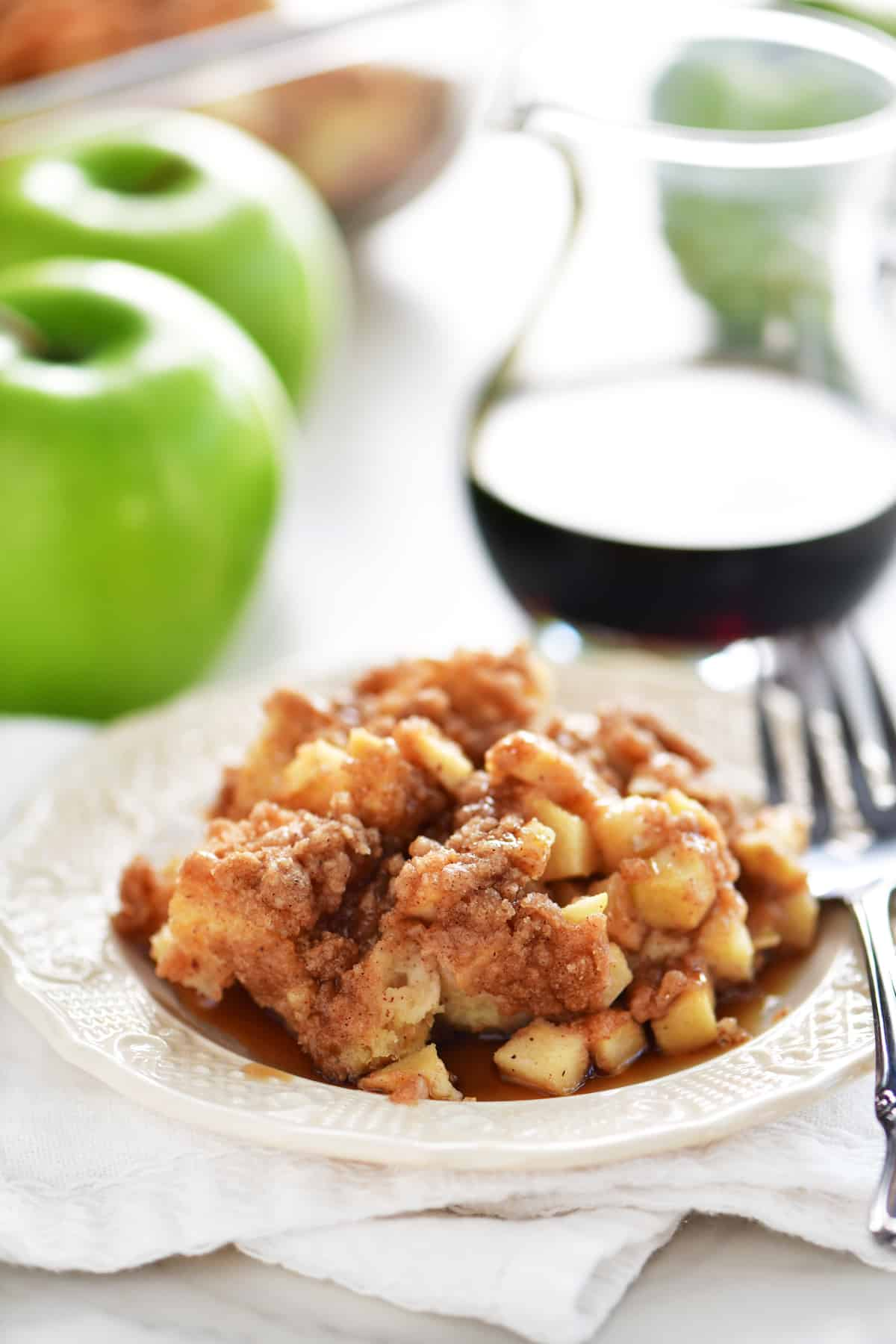 apple cinnamon french toast casserole on plate with fork