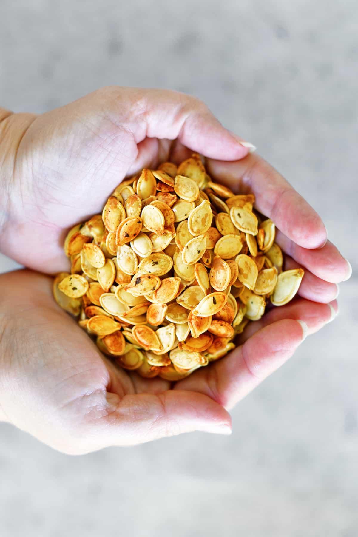 handfuls of pumpkin seeds