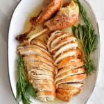 carved turkey on platter for how to cook a turkey recipe