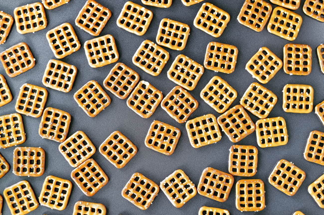 square pretzels on baking sheet for Thanksgiving candy bar pretzel bites