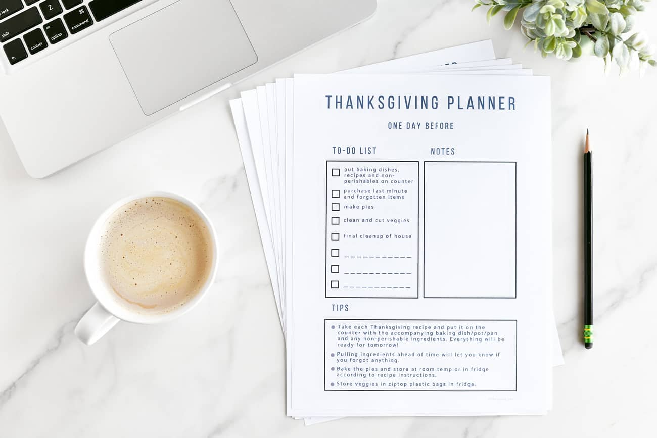 Thanksgiving Countdown Planner and Checklist on table with coffee and laptop