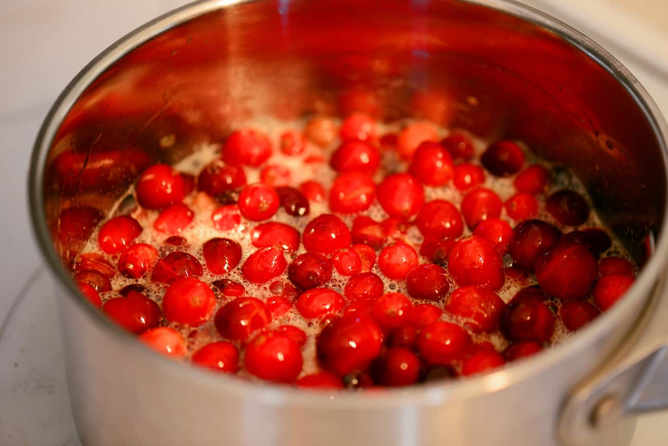 cooking the cranberry sauce on the stovetop in saucepan