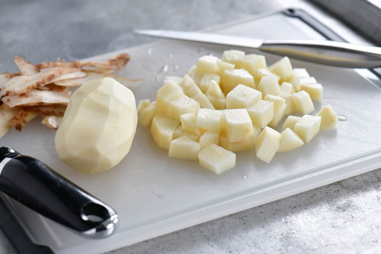 diced potatoes on cutting board for slow cooker mashed potatoes