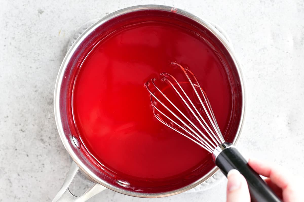 translucent jello in saucepan for strawberry jello salad