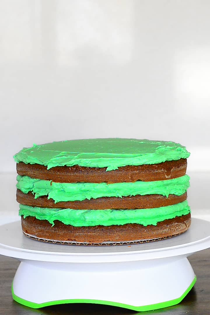 frost the third layer of the chocolate mint layer cake