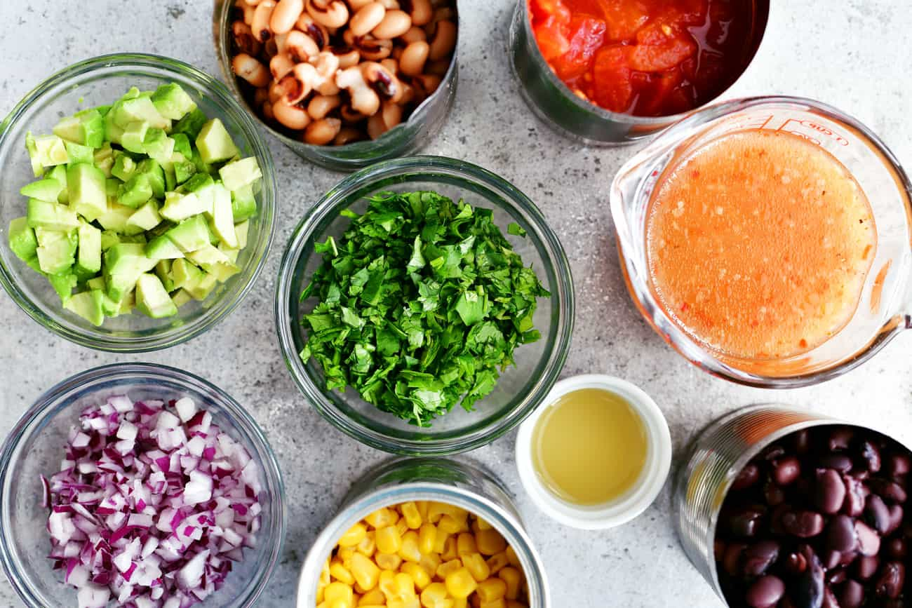 cowboy caviar ingredients in small bowls and cans