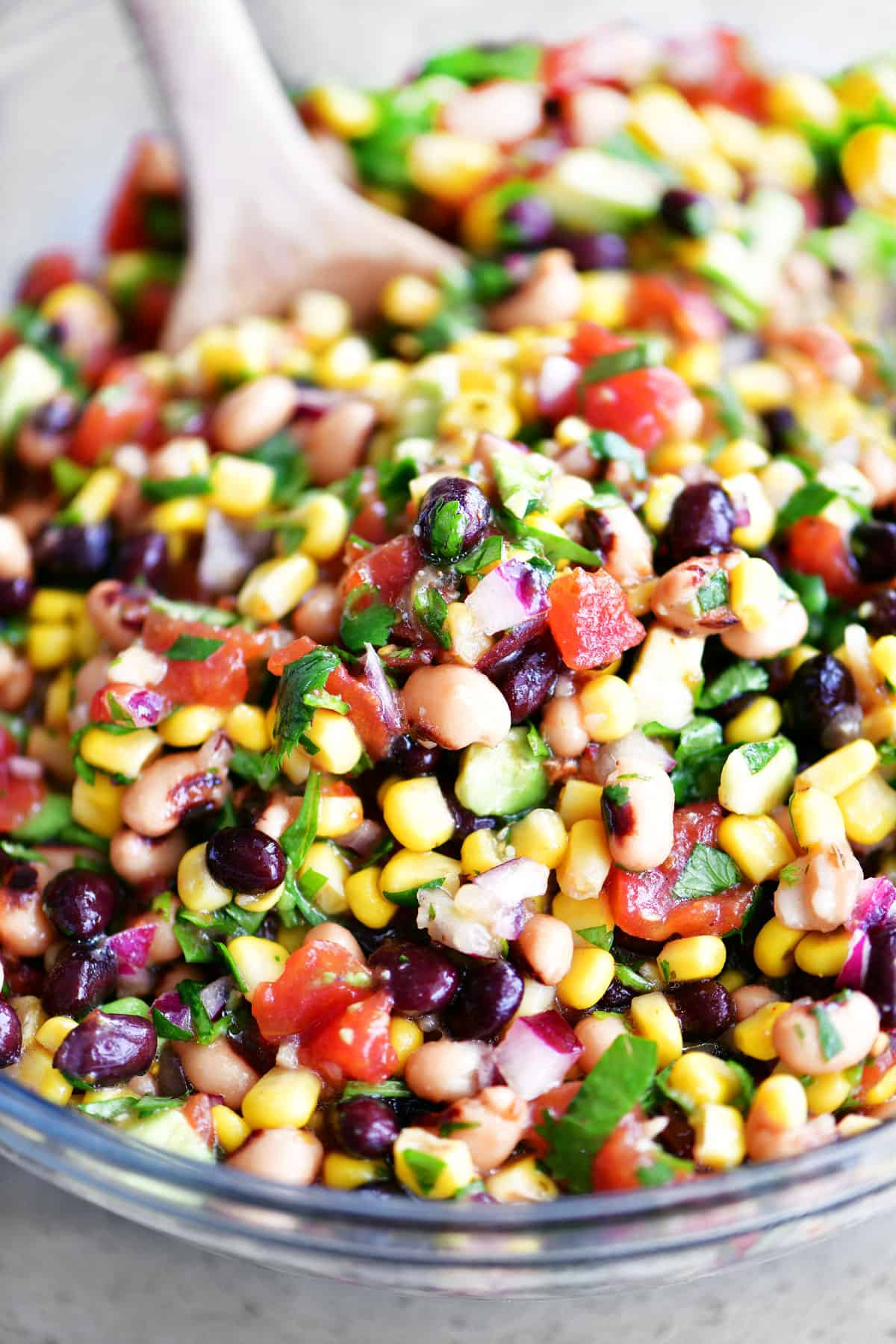 cowboy caviar in bowl with a wooden spoon