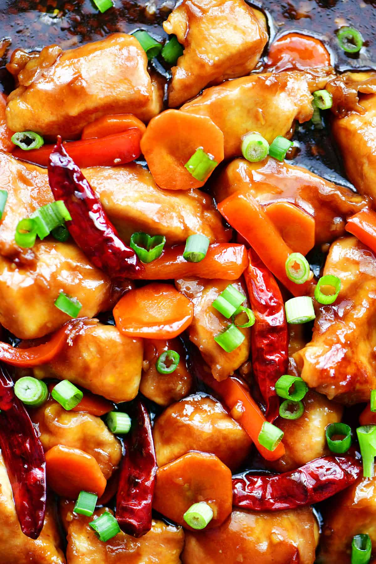 genearl tso chicken topped with green onions