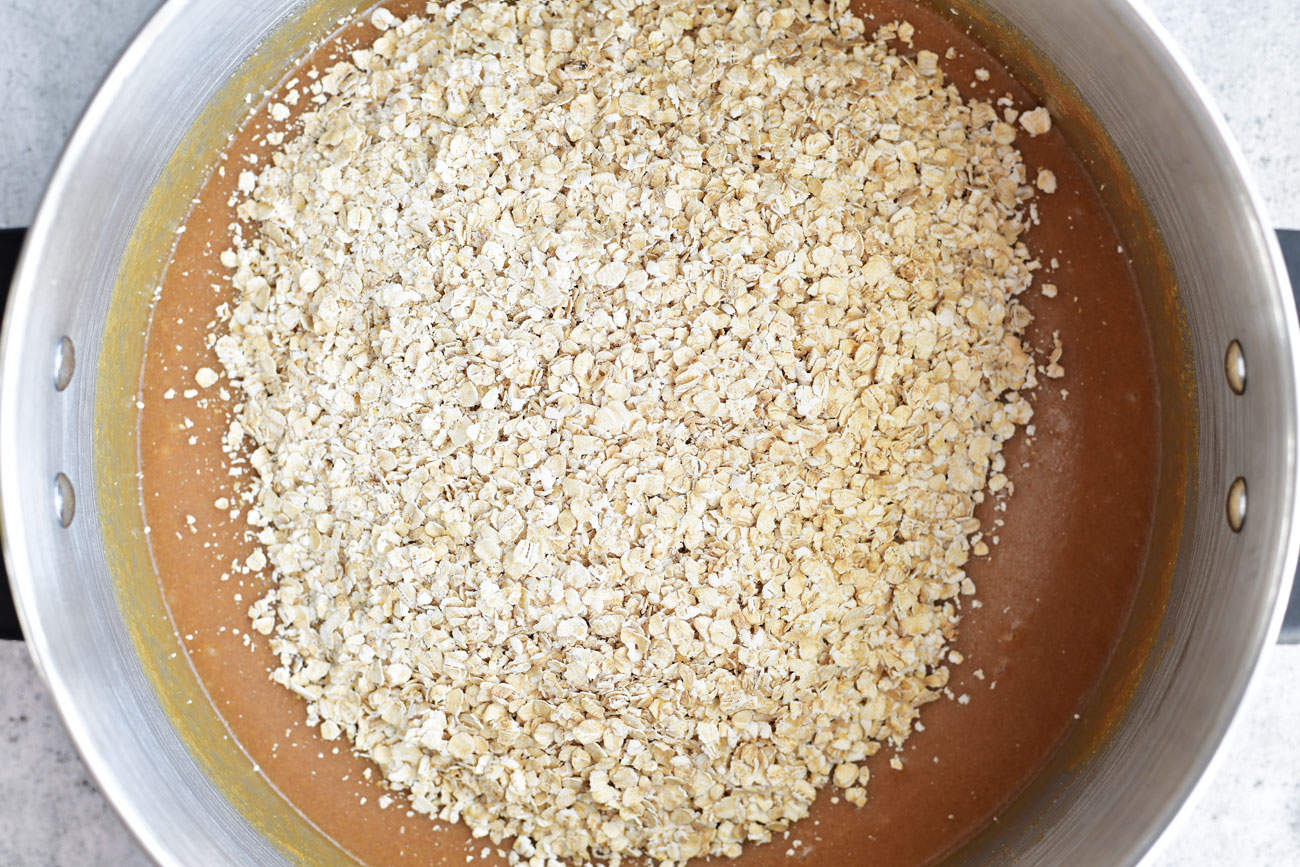 oats with peanut butter mixture in saucepan