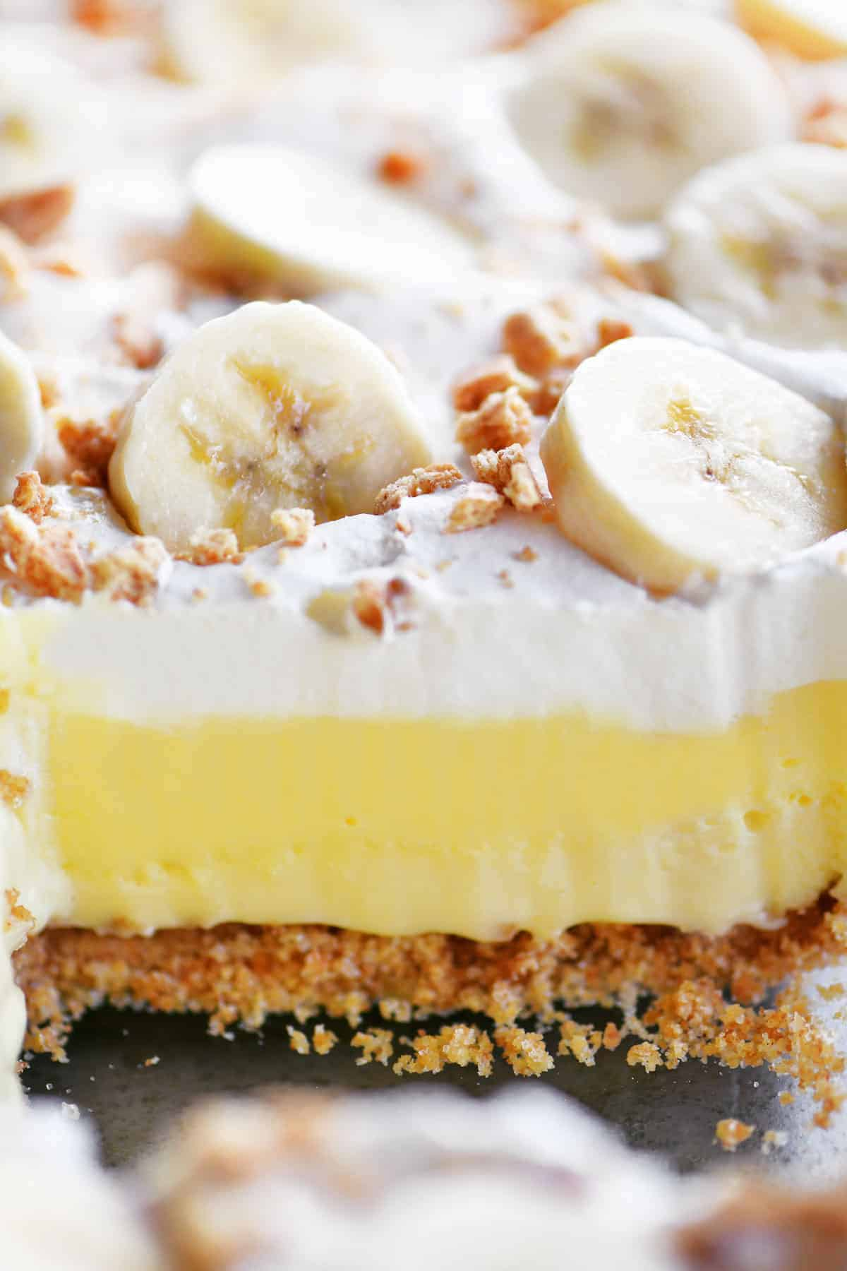 banana cheesecake dessert layers in slice