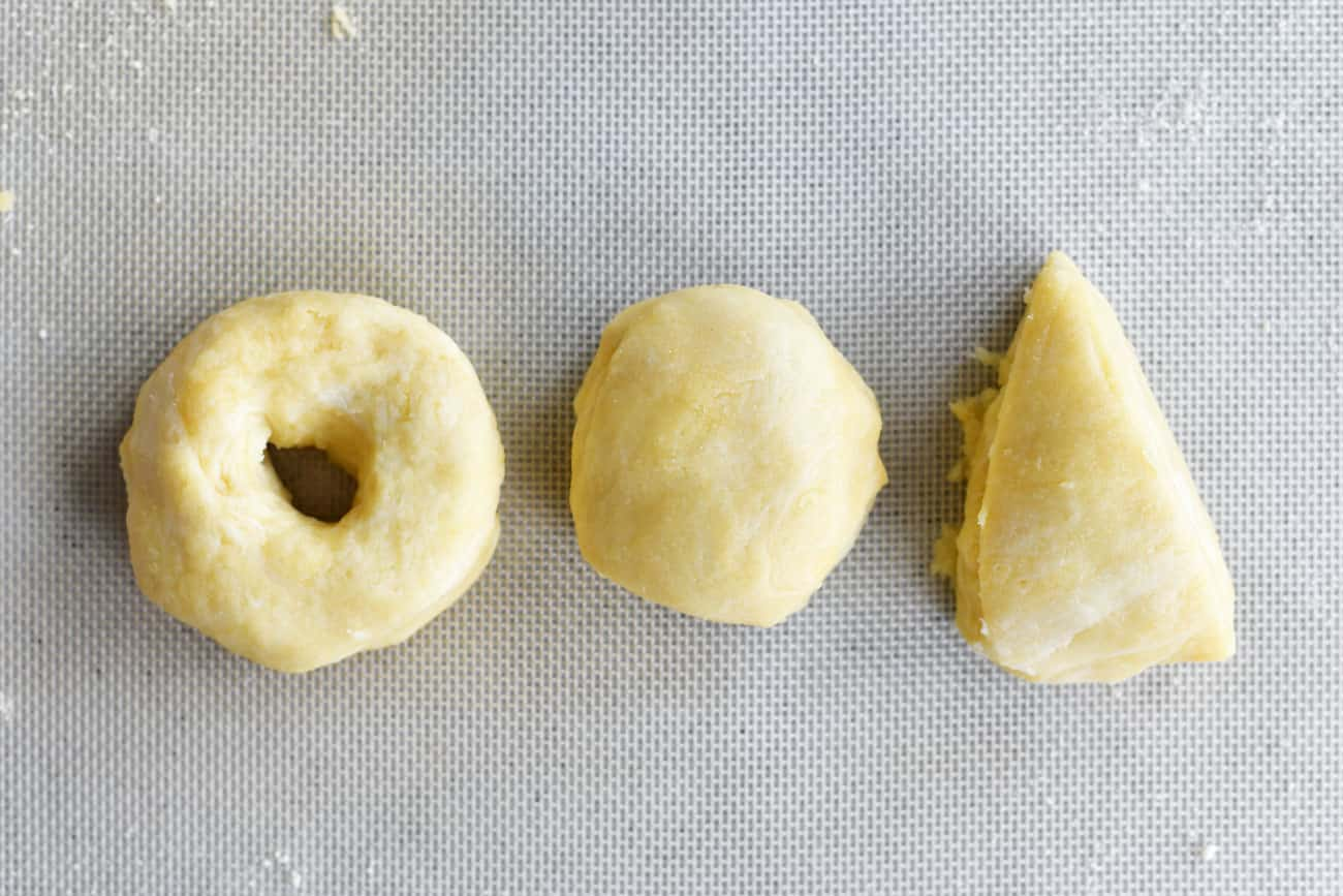 a triangle of dough with a ball of dough and a bagel shape of dough
