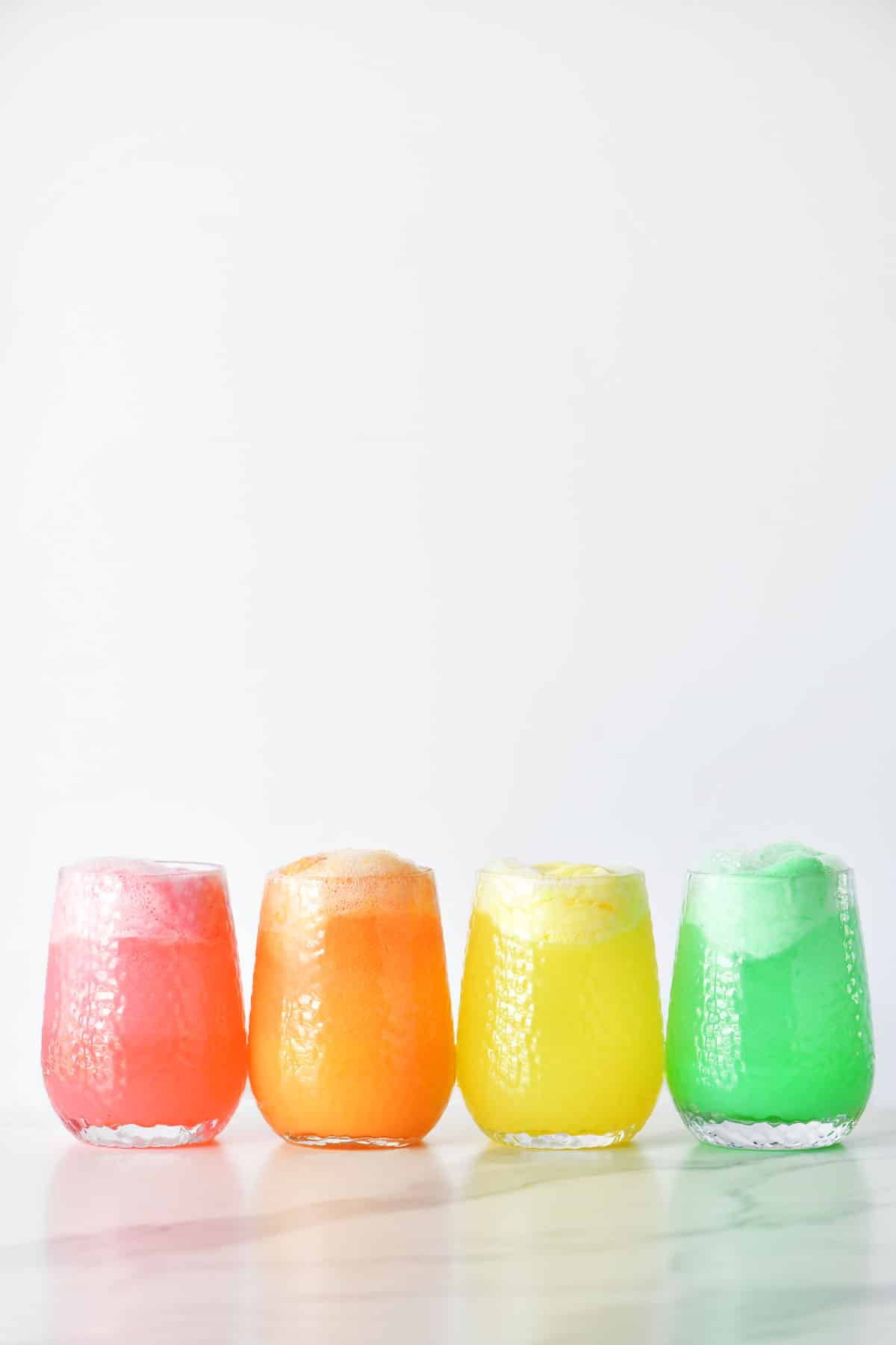 four kinds of sherbet punch in cups