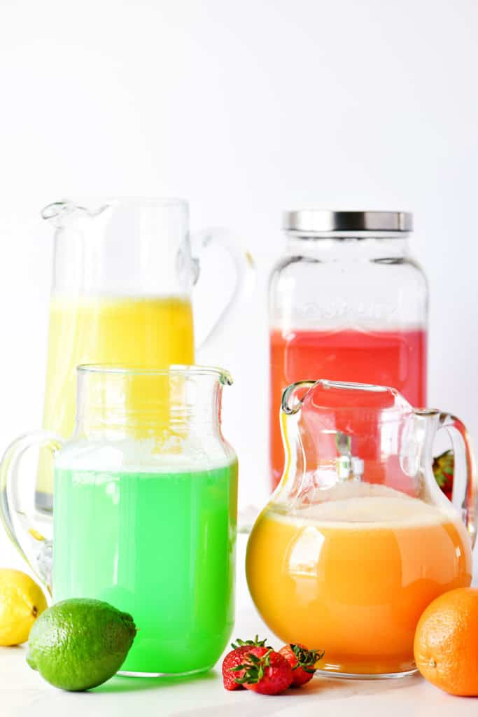 strawberry, orange, lemon and lime sherbet punch in pitchers